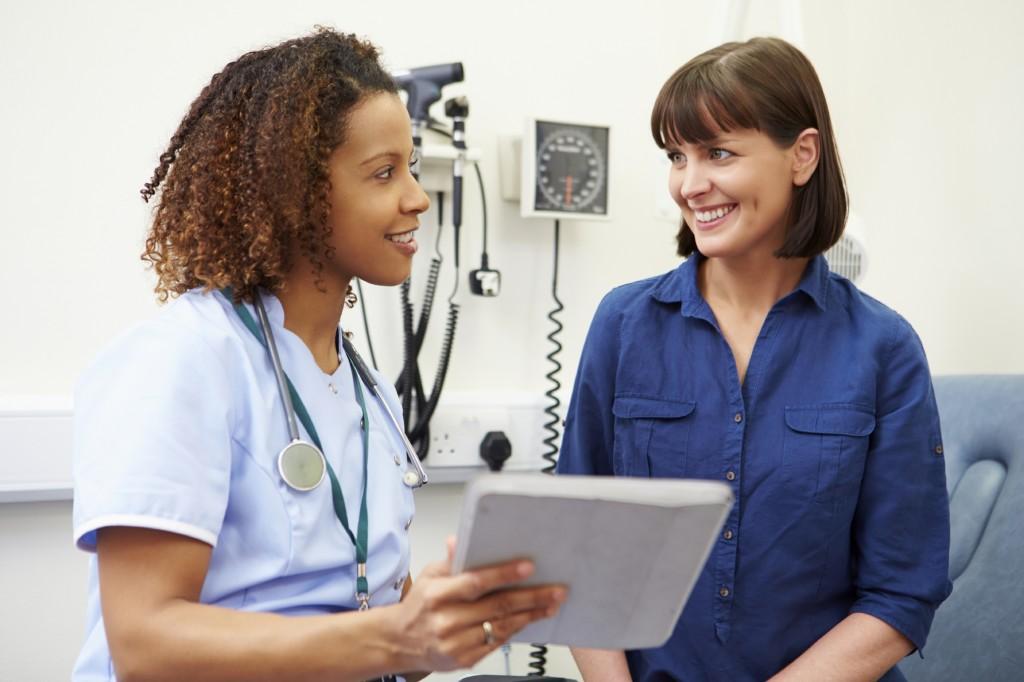 Nurse Showing Patient Test Results On Digital Tablet